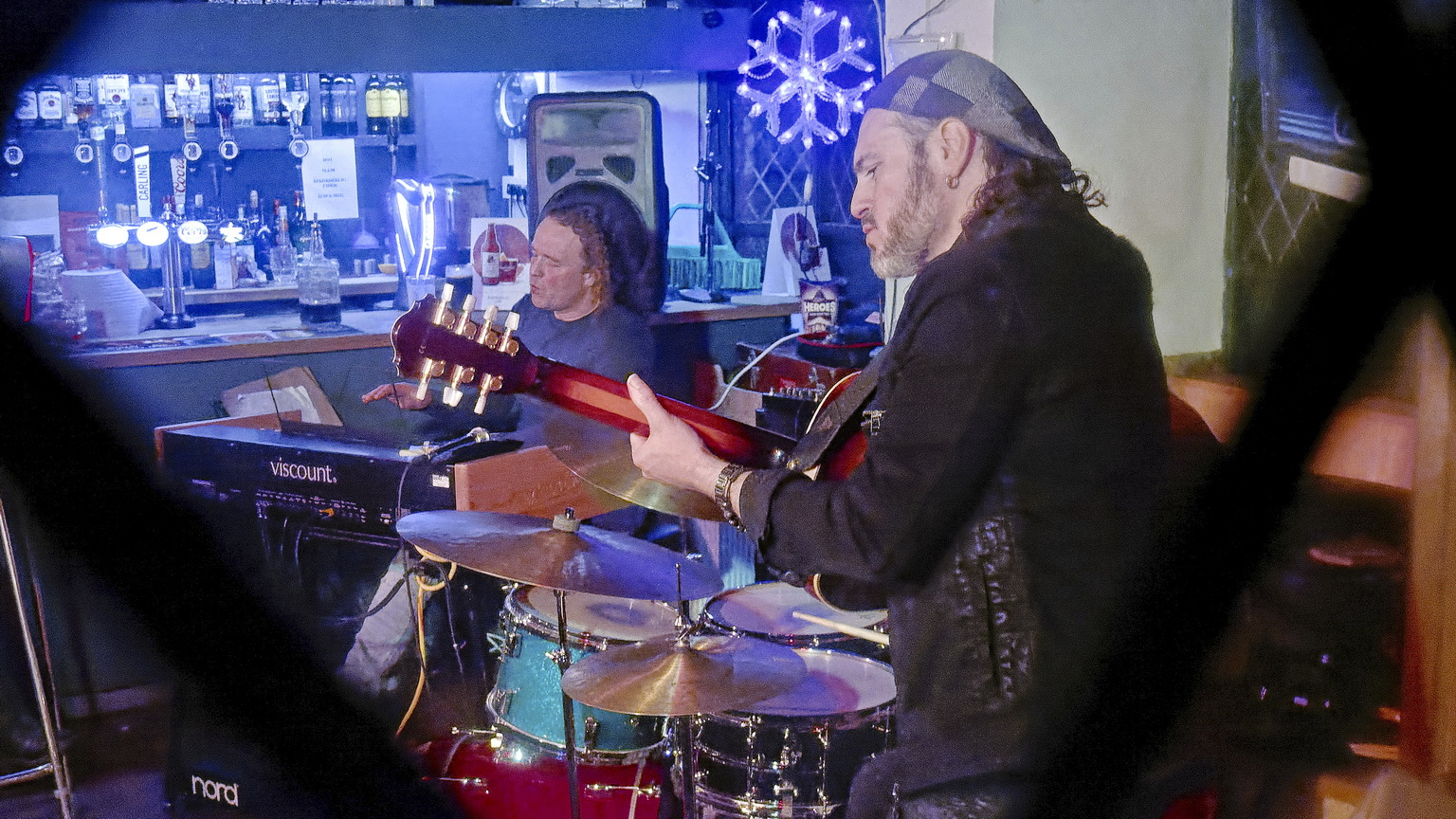John Paul Gard Xmas Gig at Monmouth's Queen's Head seen from the street through the leaded lights